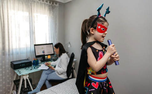 Girl singing in disguise while her mother teleworking