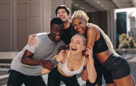 Cheerful fitness group outdoors