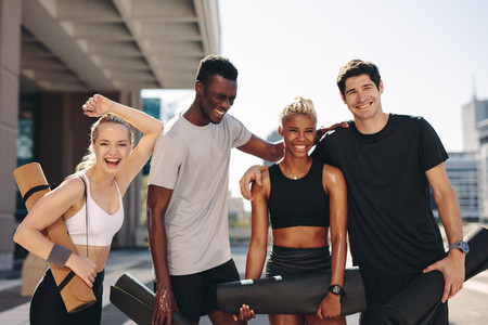 Healthy fitness group standing outdoors