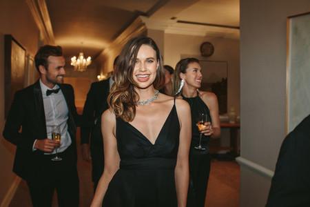 Beautiful woman with friends at gala night