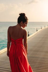 Woman in fashionable sundress on a sea vacation