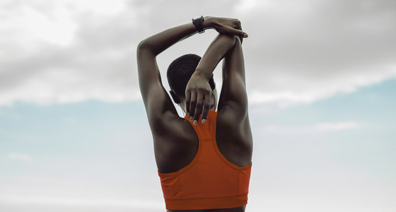 Woman doing hand stretching exercise