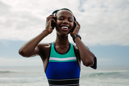 Woman enjoying listening music after workout session