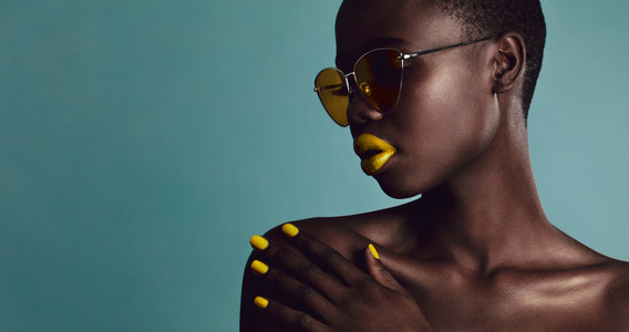 Female model bright makeup and sunglasses