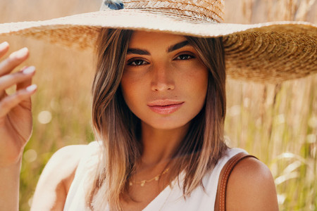 Beautiful woman in straw hat