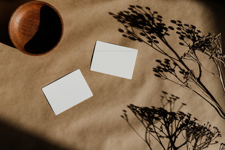 Top view of blank paper cards on a kraft paper  Mockup for business template