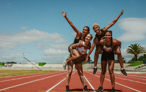 Group of sportswoman enjoying on race track at stadium