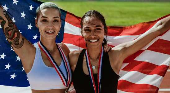 Two US athletes with national flag