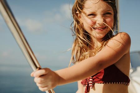 Little girl enjoying a yacht ride