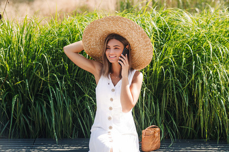 Smiling woman wearing big hat