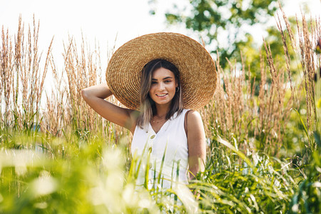Young cheerful woman wearing hat