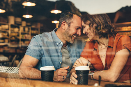 Loving couple enjoying date at cafe