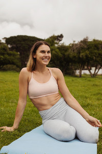 Fitness woman relaxing in park