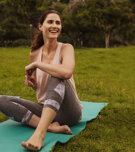 Fitness woman sitting in park