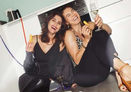Women friends having fun partying at home