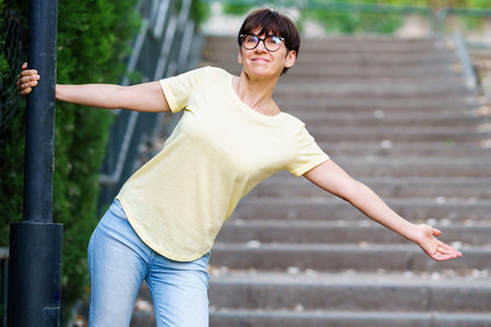 Funny happy middle aged woman in an urban park