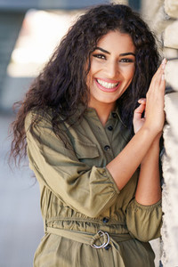 Happy Arab Woman with curly hair outdoors