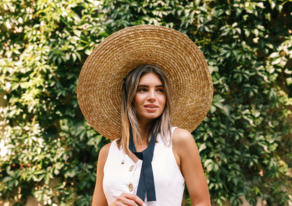 Blond woman in a straw hat