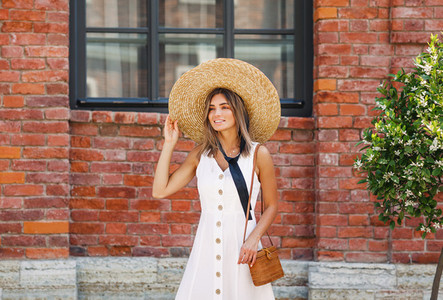 Stylish female with straw hat