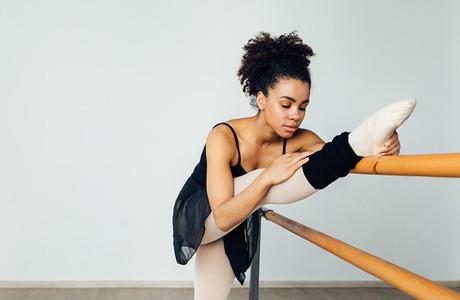Female ballet dancer stretching