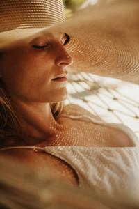 Woman in hat relaxing