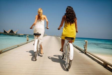 Tourists enjoying riding bicycle at a luxury resort