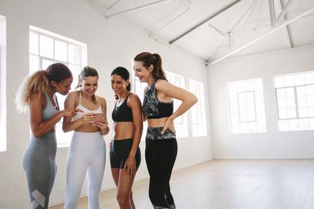 Women using fitness app