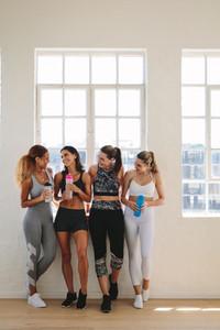 Women taking break during workout