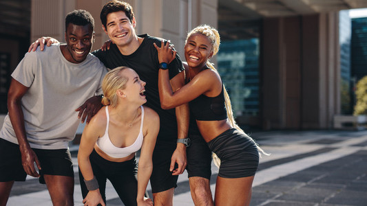 Fitness group enjoying themselves outdoors