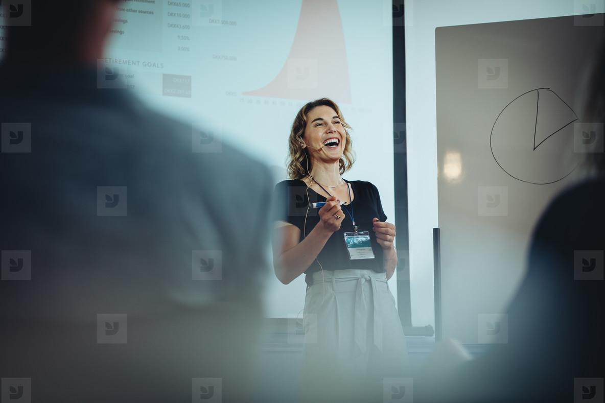 Businesswoman smiling during presentation speech