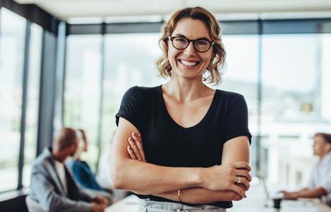 Successful businesswoman standing in meeting room