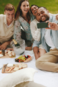 Group of friends having fun together and taking selfie