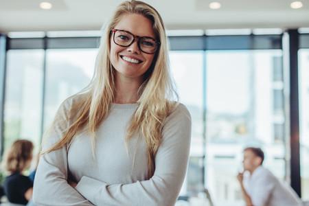 Portrait of confident businesswoman in boardroom