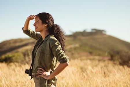 Portrait of a tourist woman outdoors