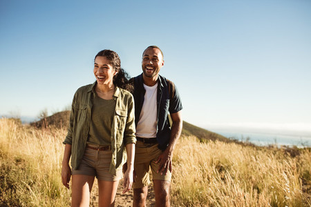Smiling couple on a hiking adventure