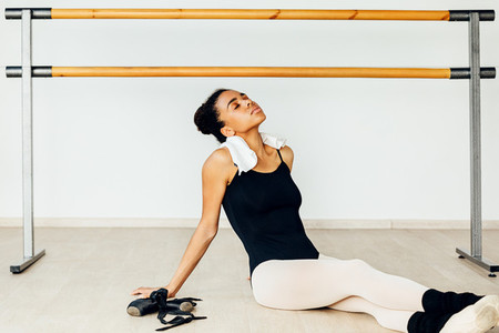 Young ballerina resting