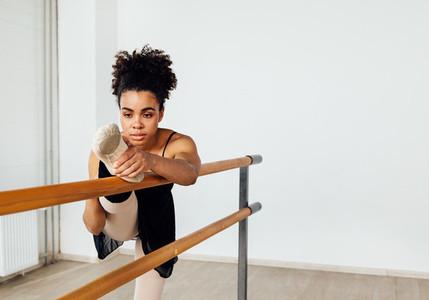 Ballerina stretching her leg