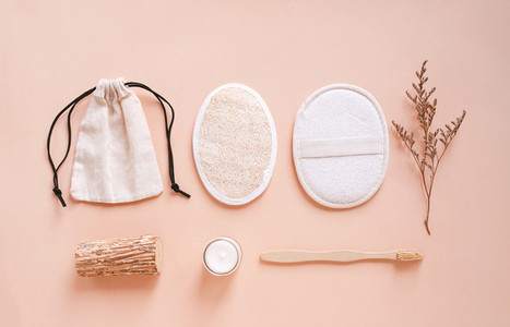 Flat lay of sustainable products bamboo toothbrush skin scrub