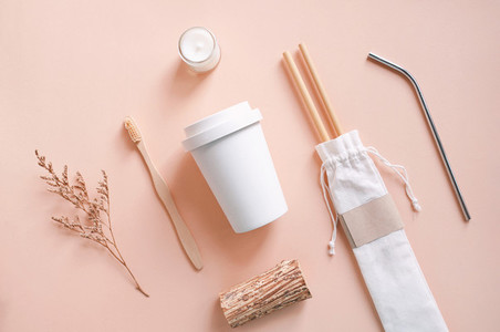 Flat lay of sustainable products  bamboo toothbrush  straw in sa