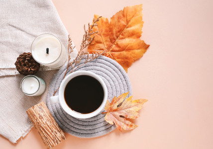Flat lay of autumn holiday concept background  candle  maple lea