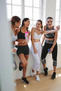 Fitness women having fun during workout break