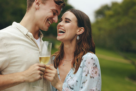 Couple at park with champagne