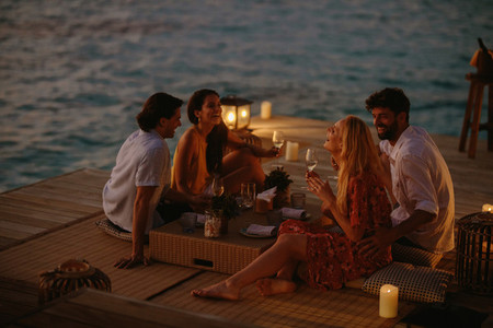 Friends on a luxury holiday on an overwater villa