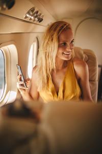 Woman enjoying her travel in an airplane