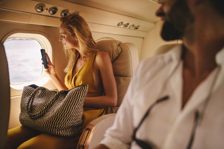 Woman on a holiday in a charter plane
