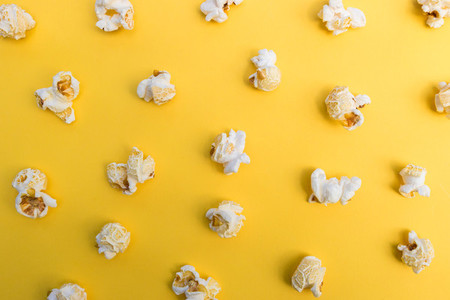 Popcorn on yellow color background minimal food