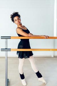 Young ballerina standing indoors