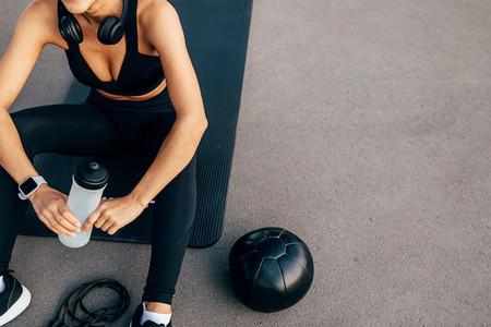 Unrecognizable fitness woman
