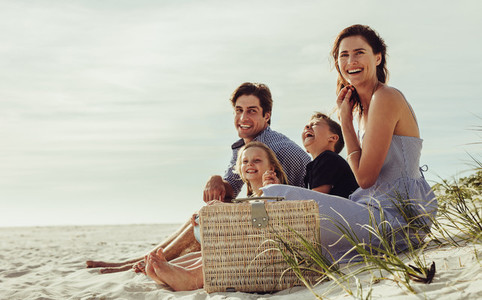 Family enjoying a summer weekend at the beach