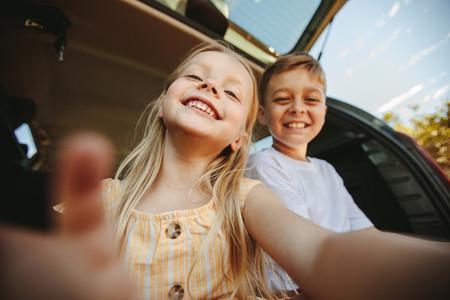 Happy kids taking selfie